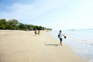 A more quiet end of Kuta beach still offers beachfront restaurants and surfboard rentals.