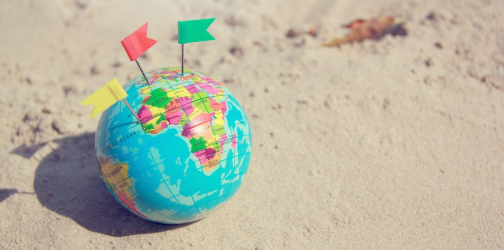 Image of a globe with destination pins