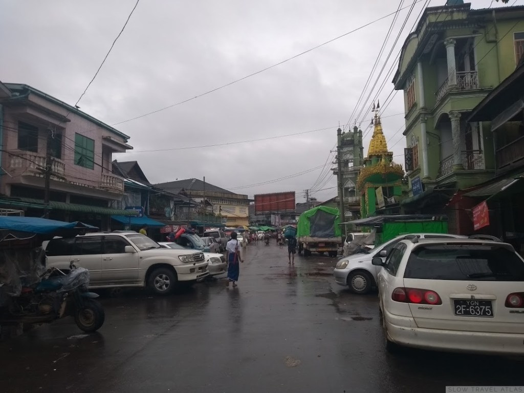 A busy street in Hpa-An on a rainy day