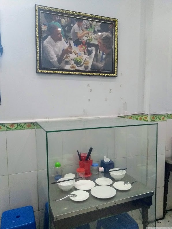 Glass-enclosed table at Bun Cha Huong Lien