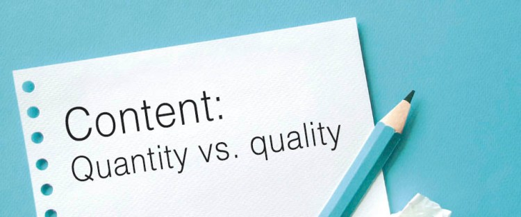 Piece of paper and a pen with the text content: quantity vs. quality