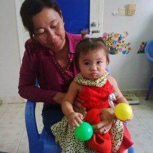 A little girl from the NPH Cleft Clinic playing with our new assessment toys!