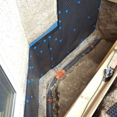 Membrane and foundation wrap applied for waterproofing solution, along with a few other measures