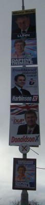 five posters, four parties, one lamppost