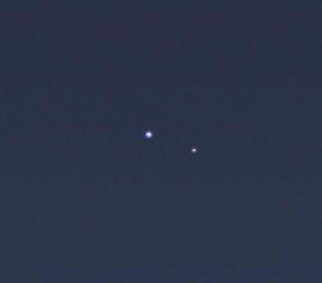 Magnified Cassini image of Earth and Moon