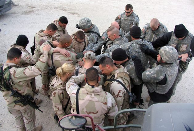 SOUTHWEST ASIA (AFPN) -- Airmen and Soldiers take a moment to pray for each other's safety before heading out for another day of convoy duty in Iraq. The Airmen run the convoys into Iraq and the Soldiers, in their armored trucks, escort them. (U.S. Air Force photo by Staff Sgt. Scott Campbell)