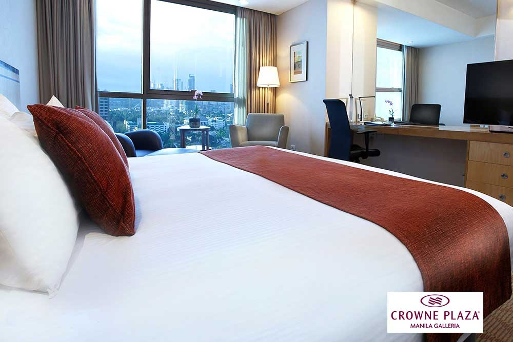 deluxe bedroom at Crowne Plaza