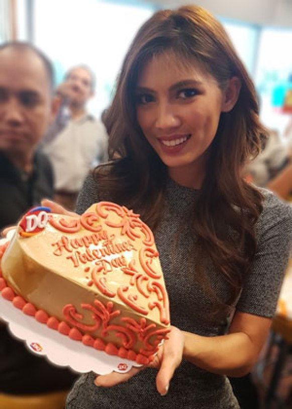 Nicole Cordoves with the Dairy Queen Blizzard heart shaped Valentine ice cream cake.