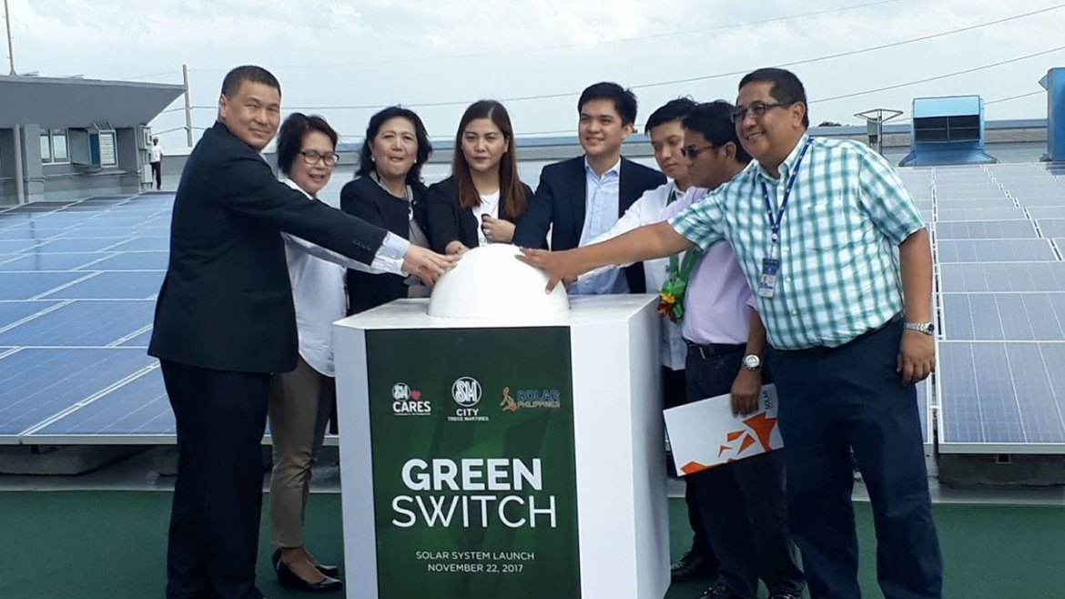At the launch of The Green Switch from left to right: Senior Vice President For Marketing Jonjon San Agustin; SM Vice President for Operations Lisa Silerio; SM Supermalls President Annie Garcia; Mrs. Aiza De Sagun, representing Trece Martires Mayor Melendres De Sagun; Solar Philippines President Leandro Leviste; Executive Assistant Vincent Bae; Engineer Ernesto Cenizal; and Regional Operations Manager Dominador Caringal, Jr.