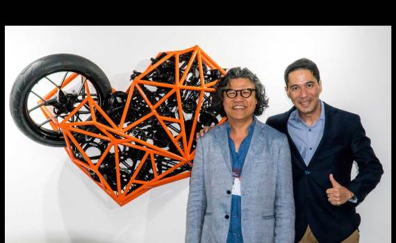 Artist Pete Jimenez and Dino Santos of KTM Philippines with the KTM inspired art piece
