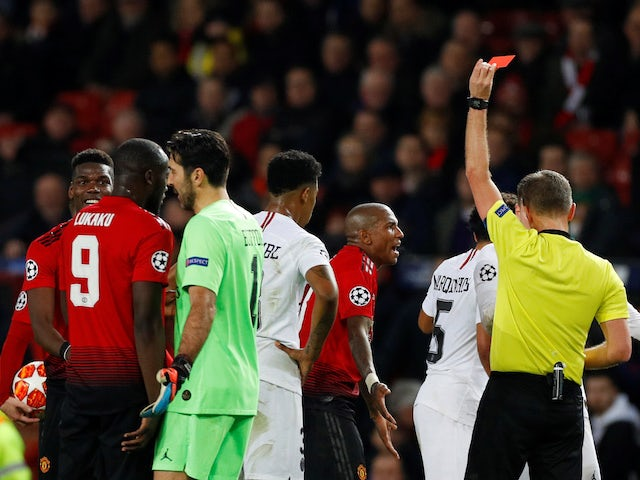 Manchester United midfielder Paul Pogba is shown a red card against PSG on February 12, 2019