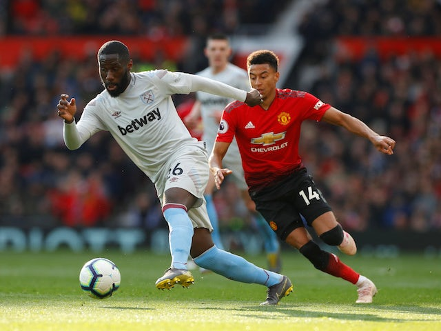 Manchester United's Jesse Lingard in action with West Ham United's Arthur Masuaku in the Premier League on April 13, 2019