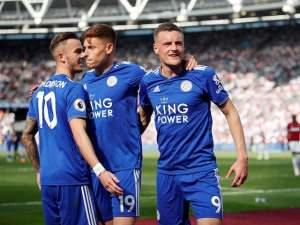 Leicester City's Jamie Vardy celebrates scoring their first goal against West Ham with James Maddison and Harvey Barnes on April 20, 2019