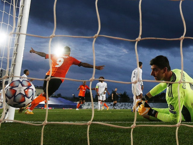 Real Madrid's Thibaut Courtois reacts after Raphael Varane scores an own goal against Shakhtar Donetsk in the Champions League on October 21, 2020