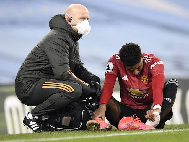 Manchester United forward Marcus Rashford gets treatment for an injury on March 7, 2021