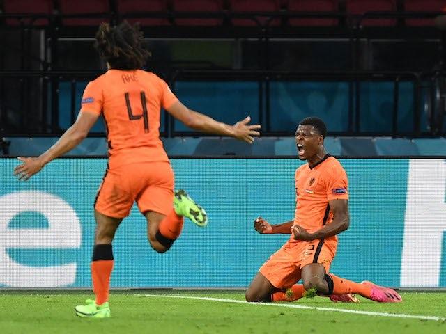 Netherlands' Denzel Dumfries celebrates scoring against Ukraine at Euro 2020 on June 13, 2021