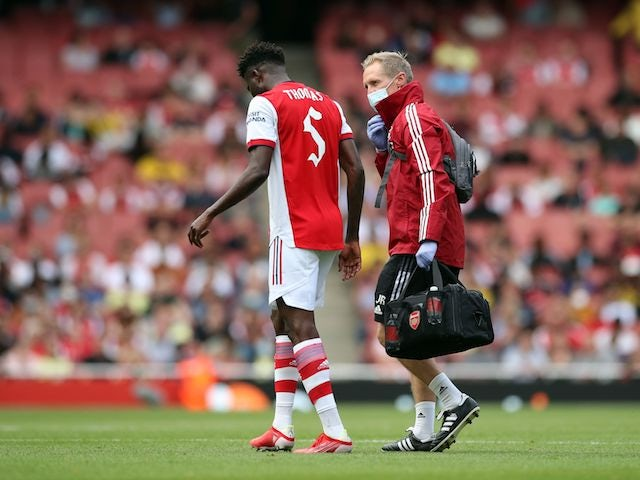 Arsenal's Thomas Partey receives medical attention on August 1, 2021