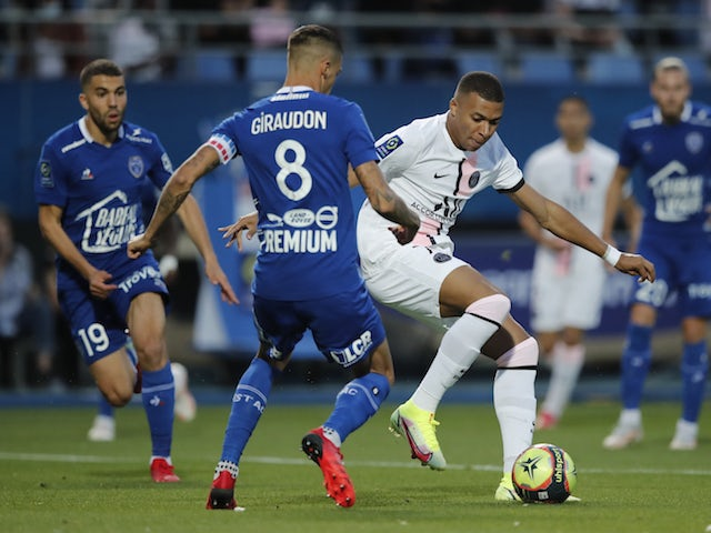 Paris Saint-Germain's Kylian Mbappe in action with Troyes' Jimmy Giraudon on August 7, 2021