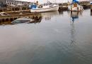 Bil og trailer endte i havnen