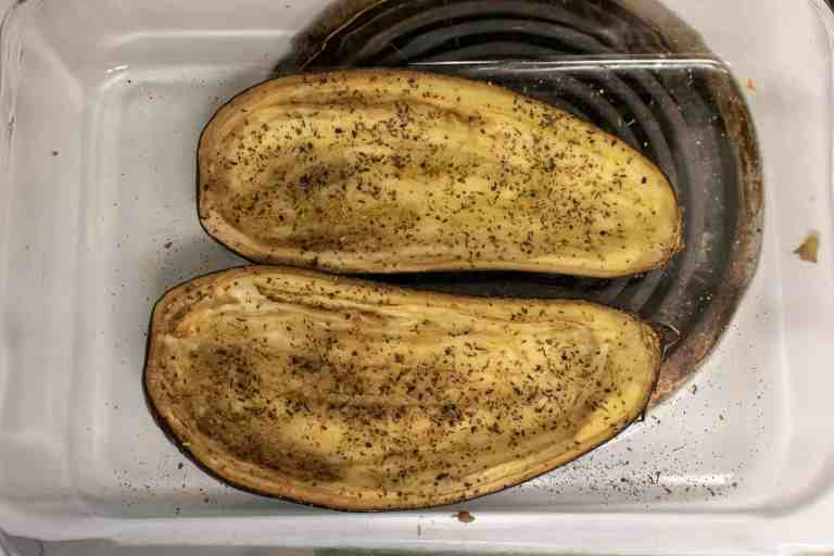Two halves of eggplant after roasting to a golden color.