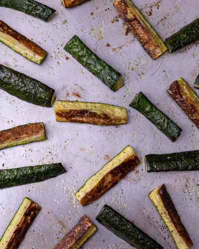 Roasted zucchini on a sheet tray