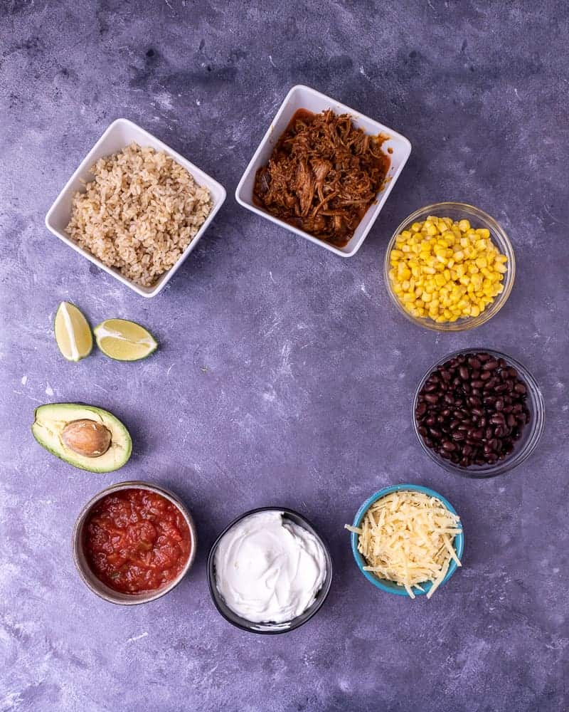 Ingredients laid out for pork burrito bowls.
