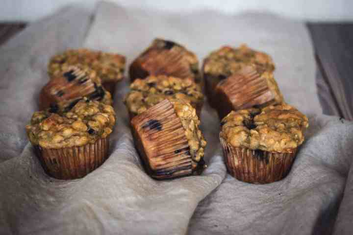 nine gluten free blueberry oat muffins on a napkin