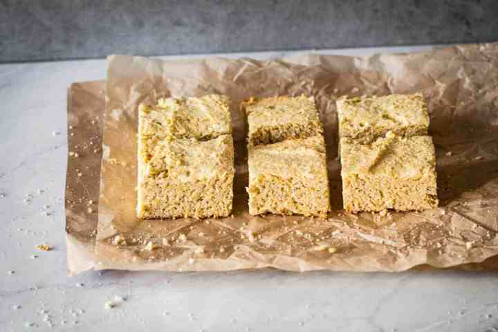 six pieces of gluten free cornbread on parchment paper