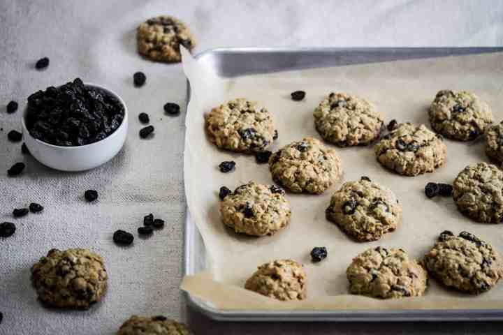 cookie sheet with gluten free oatmeal raisin cookies