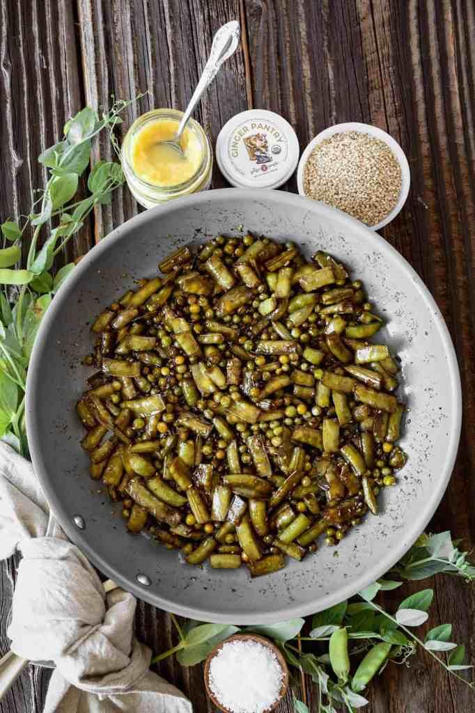 a frying pan of stir fry sugar snap peas