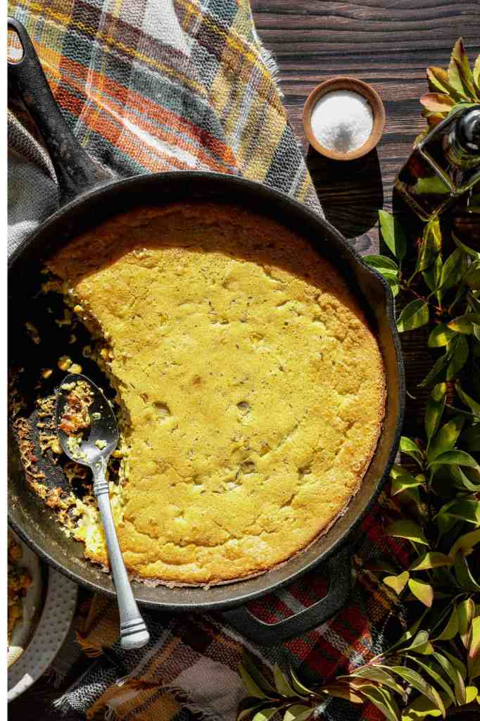 a cast iron skillet of gluten free corn pudding skillet