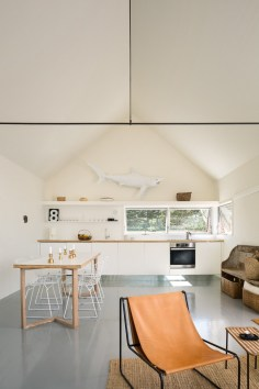 A trio of tiny cabins forms a seasonal vacation retreat in an old quarry. One cabin is the living/dining/kitchen pavilion, the other two are sleeping cabins.   www.facebook.com/SmallHouseBliss
