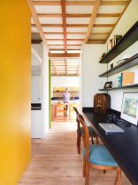 A small house in Ecuador built with sustainable materials and a green roof. It has one bedroom in 524 sq ft. | www.facebook.com/SmallHouseBliss