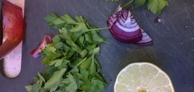 Cutting board with lime, onion, and parsley