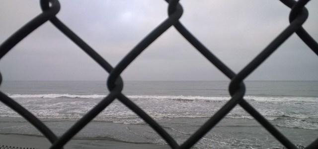 Ocean Behind Cyclone Fence www.smalllifedetails