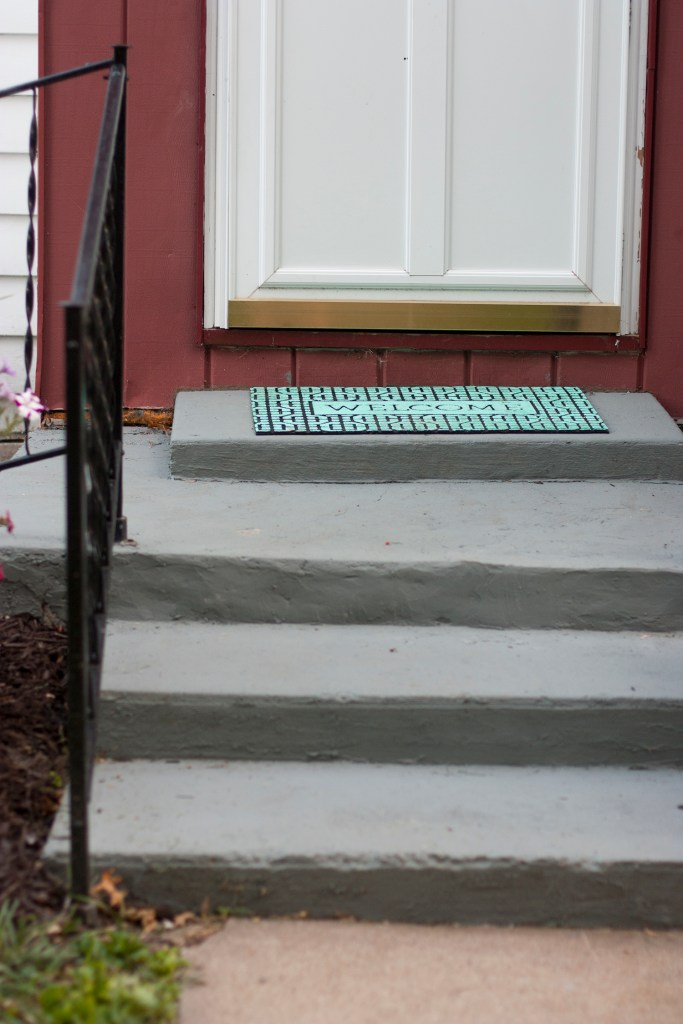 I so need to do this to our front steps! Wow! All she used is Quikrete and paint to make them look so much better than the old outdoor carpet and crumbling steps.