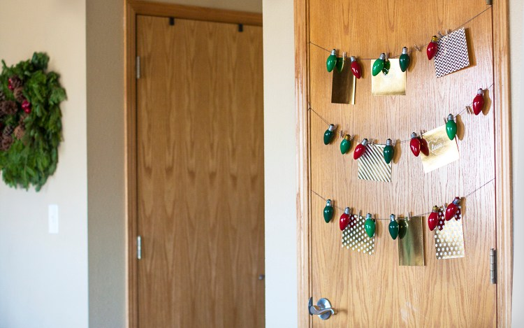 Smart idea to display Christmas cards on a closet door! #DecoArtProjects #ChristmasCards #ChristmasCardDisplay #Christmas #ChristmasDecor #DIYChristmas