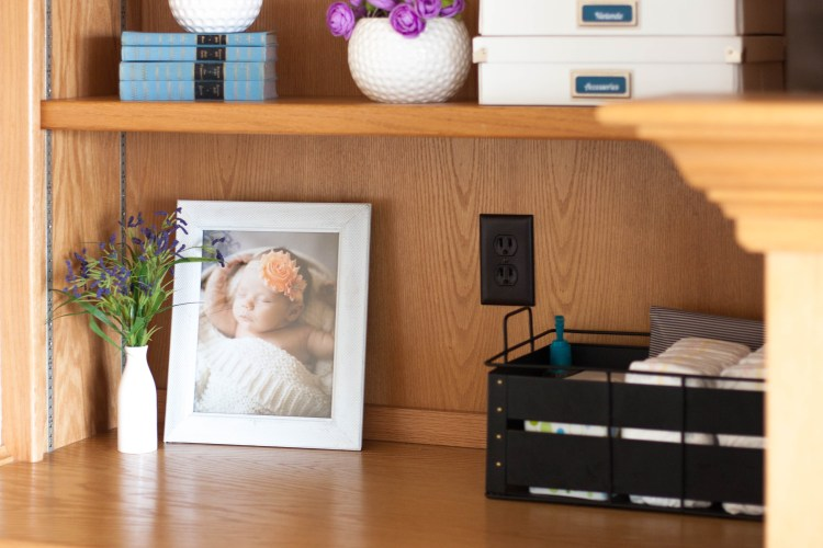 diaper-changing-station-on-shelf-in-living-room