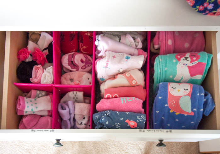 organized dresser drawer with baby clothes
