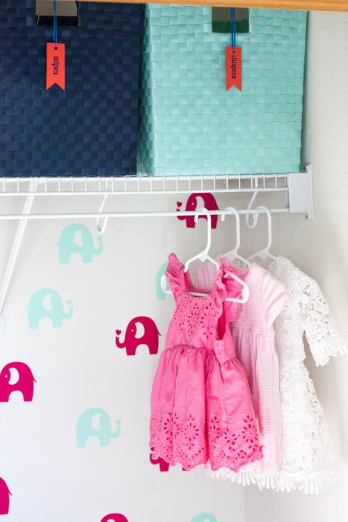 organized-nursery-closet-with-elephant-wallpaper