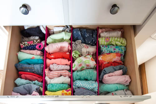 organized-baby-clothes-in-dresser-drawer