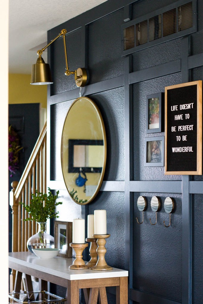 mirror-on-navy-board-and-batten-hallway-wall