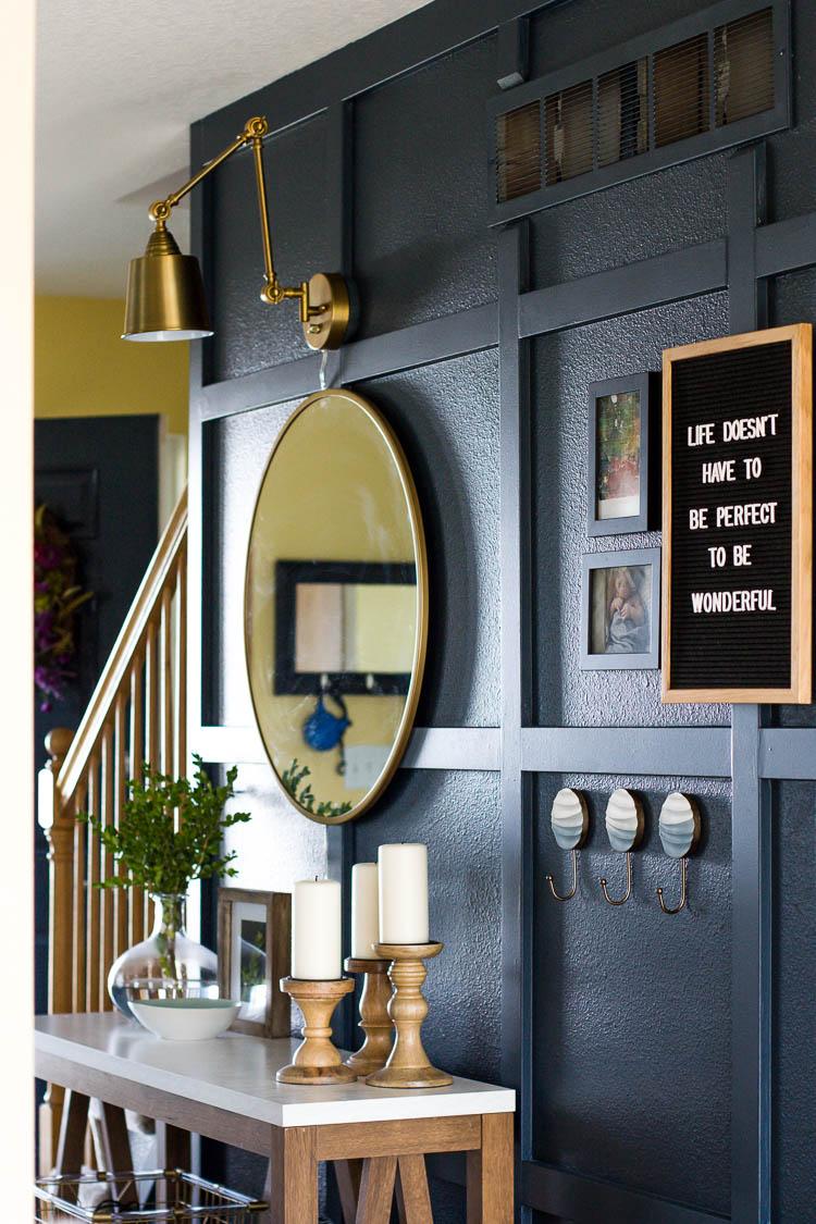 mirror-on-navy-board-and-batten-hallway-wall