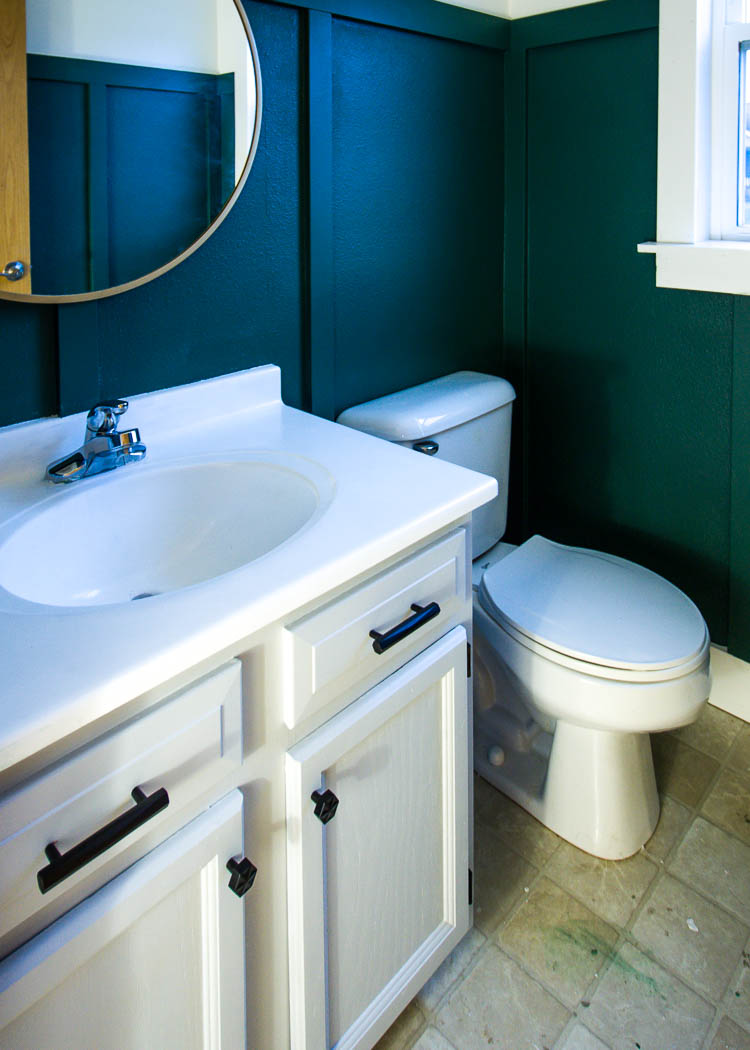 green-bathroom-white-vanity