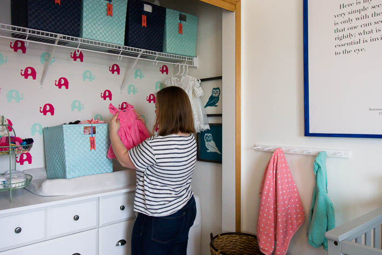 mom-organizing-baby-clothes