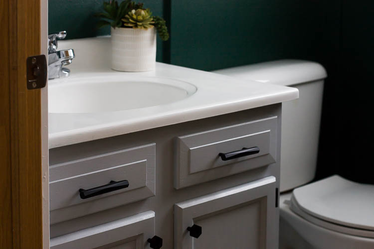 painted-vanity-with-black-hardware