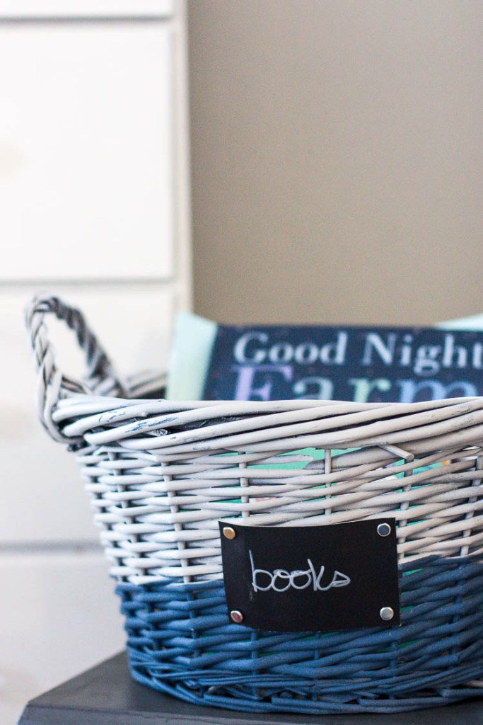 painted-wicker-basket-with-label-that-says-books