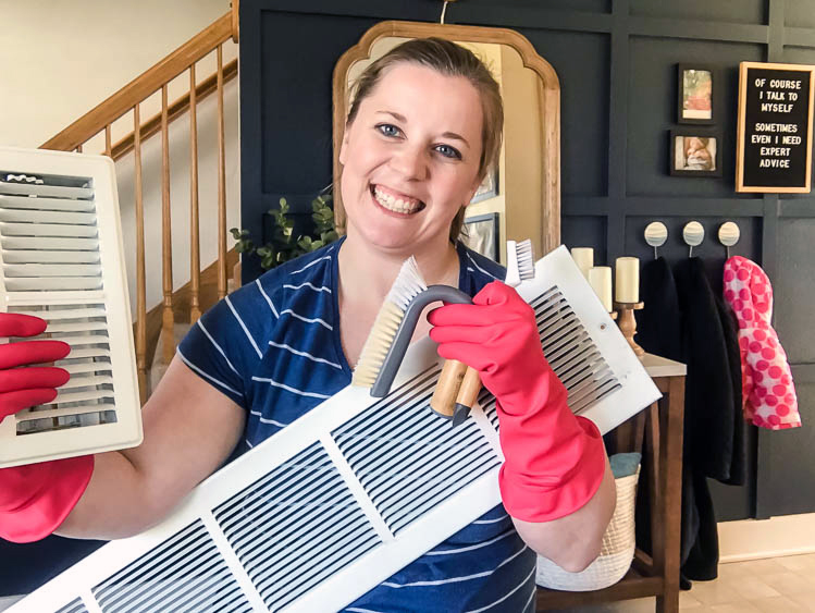 emily-counts-holding-air-vents-wearing-pink-rubber-gloves