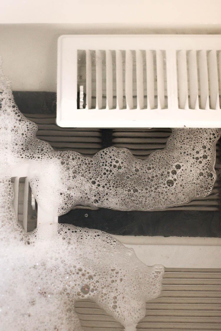 dirty-air-vents-soaking-in-bathtub