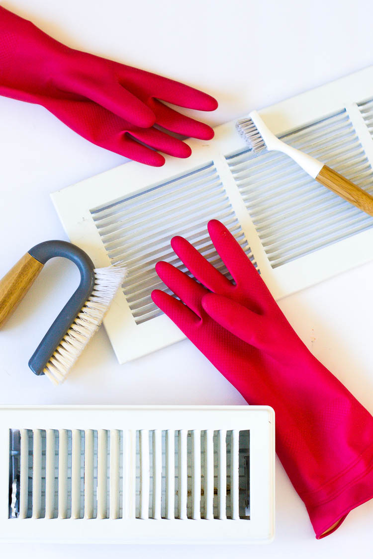 flatlay-of-white-air-vents-and-pink-rubber-gloves